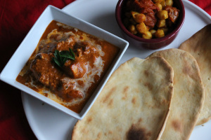 India with Butter chicken, Chana Dal and Naan