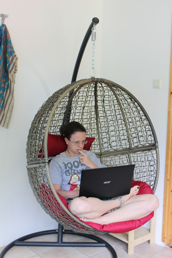 me writing in my egg chair