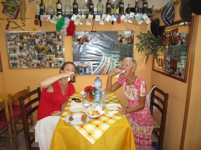 Mom and I eating cannoli in Palermo